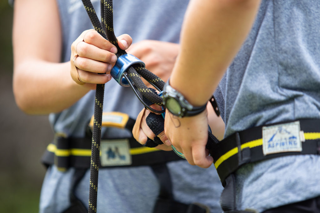 Preparing the harness to climb the high ropes.